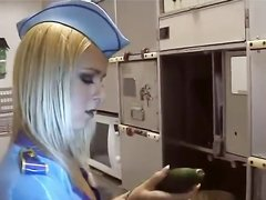 Стюардесса трахает свои дырки двумя огурцами одновременно