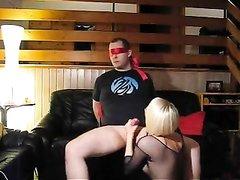 Беспомощный парень в маске связан и трахнут похотливой блондинкой