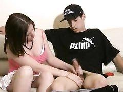 Молодая девушка руками снимает сексуальное напряжение своему парню