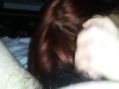 Рыжая азиатка в любительском видео от первого лица дрочит член приятеля