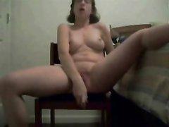 Раскинув шире ноги развратница приступила к анальной мастурбации с секс игрушкой
