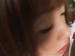 Рыжая японская нимфоманка балдеет от группового секса в постели на белой простыни
