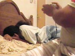 Мужик снял на камеру любительский секс с куни с азиатской женой в постели