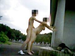 Зрелую японка на улице стоя трахает в волосатую киску молодой любовник