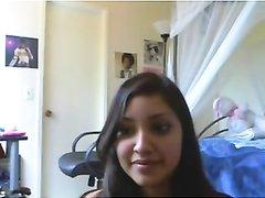 Молодая брюнетка напротив вебкамеры исполнила любительский стриптиз