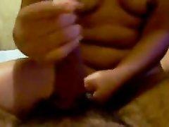 Худая азиатка на домашнюю камеру от первого лица двумя руками дрочит член