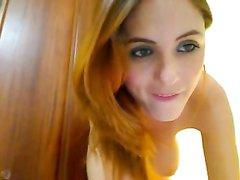 Рыжая грудастая леди занялась любительской мастурбацией на вебкамеру