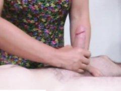 Заботливая дама двумя руками дрочит член и гладит яйца возбуждённого любовника