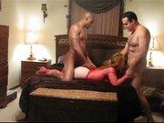 Скрытая камера снимает секс втроём рыжей девушки в чулках с мужем и негром