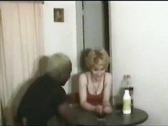 Негр лижет волосатую киску зрелой блондинки в чулках и трахает её чёрным членом