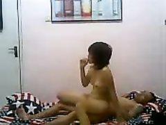 Азиатка раздевшись перед домашней скрытой камерой изменила супругу в отеле