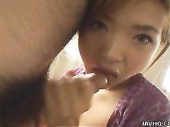 Рыжая молодая азиатка дрочит член и строчит домашний минет с окончанием на лицо