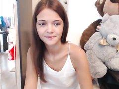 Стриптиз перед вебкамерой и домашняя мастурбация рыжей молодой шлюхи