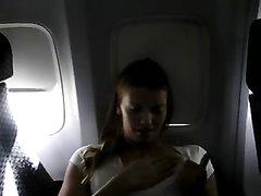 Молодая француженка на борту самолёта не скучает, она сунула руку в трусики и дрочит клитор на камеру своего друга