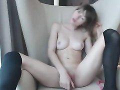 Молодая японка в коротких чулках достала подаренную секс игрушку, чтобы трахнуть себя перед вебкамерой